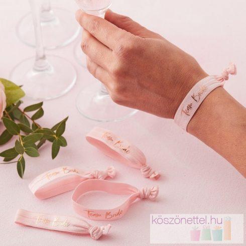 Team Bride - rózsaszínű lánybúcsús karkötők (5 db-os csomag)